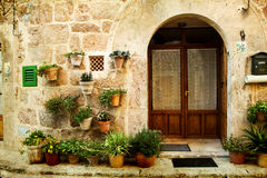 House in village Valldemossa in Mallorca, Spain. Vintage photo of traditional house in mediterranean village Valldemossa Mallorca, Spain Royalty Free Stock Photo