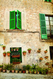 House in village Valldemossa in Mallorca, Spain. Vintage photo of traditional house in mediterranean village Valldemossa Mallorca, Spain Royalty Free Stock Photography