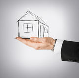 House on virtual screen in man hand Stock Photo