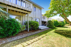 House with walkout deck and backyard garden Stock Photos