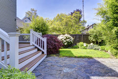 House walkout deck and backyard garden Royalty Free Stock Image