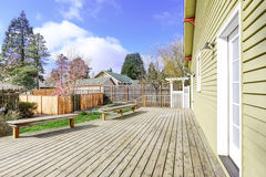 House walkout deck with two wooden benches Stock Images