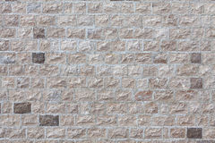 House wall faced with stone tiles Stock Photos