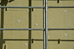 House wall with insulation material rock wool and scaffold Stock Photo
