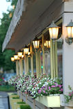 House wall with lamps and flowers of a petunia Stock Photo