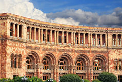 House wall of a massive building with galleries and balconies Royalty Free Stock Photo