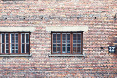 House wall. Old house wall with windows and house number Stock Images