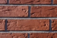 House wall with red stones Stock Photos
