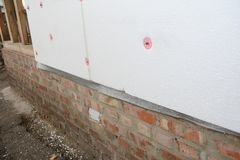 House wall renovation with external rigid styrofoam board insulation outdoor for energy saving. House wall renovation with external rigid styrofoam board Stock Photography