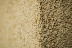 House wall texture close up. Yellow royalty free stock image