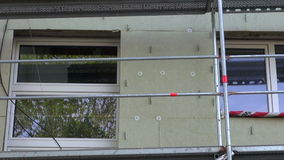 House wall thermal insulation with rock wool. Urban house wall thermal insulation with rock wool stock video