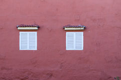 House wall with two windows royalty free stock images