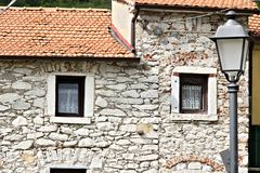House with walls in white Carrara marble in the town of Colonnat stock image