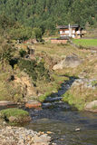 A house was built near a brook near Gangtey, Bhutan Stock Images