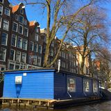 House on water in Amsterdam. Streets of Amsterdam Royalty Free Stock Photos