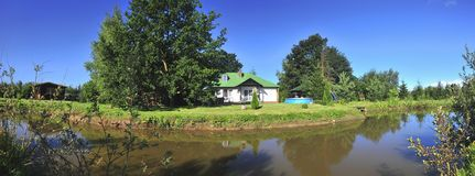 House and water panorama Stock Image