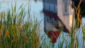 House on the water Reflection stock video