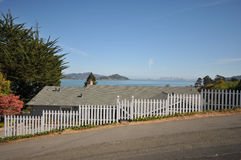 House with a water view and fence Royalty Free Stock Image
