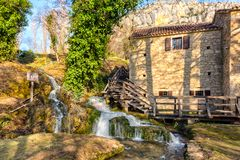 House by the waterfall. In National park Krka. The are mills in the house for grain milling. House is open for public to visit Royalty Free Stock Photos