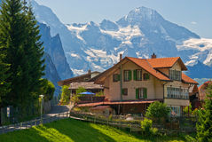 House in wengen, switzerland. A house in wengen, with the alps in the backgroud, switzerland Stock Images