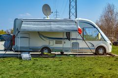 House on the wheels. Camper for travel end vacation.Camping family caravan.Holiday trip in motorhome stock image