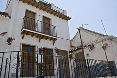 House in white andalusian village. House in white with wall pots in andalusian village Royalty Free Stock Photography