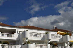 House with white facade against blue sky Royalty Free Stock Image