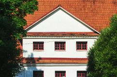 House with White Gable and Red Ceramic Roof Tiles royalty free stock photo