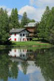House and white lake at Crans Montana, by summer Stock Photography