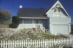 House with white picket fence Royalty Free Stock Images