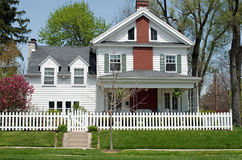 House with White Picket Fence. In urban setting Stock Image