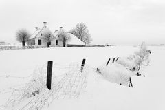 House in a white winter landscape Royalty Free Stock Images