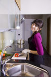 House wife slicing a red pepper Royalty Free Stock Images