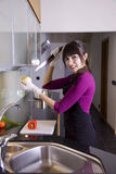 House wife stabbing an onion Royalty Free Stock Photography