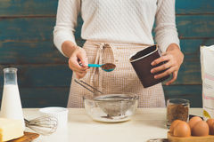 House wife wearing apron making. Steps of making cooking chocola Royalty Free Stock Images