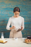 House wife wearing apron making. Steps of making cooking chocola Royalty Free Stock Photo
