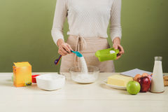 House wife wearing apron making. Steps of making cooking pancake Royalty Free Stock Photography