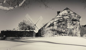 House and windmill in East Hampton Stock Photo