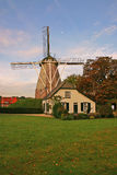 House and windmill in the Netherlands vertical Stock Photo