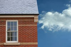 House window. Section of a new build house against a blue sky stock photo