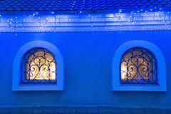 House windows, Christmas lights. Stock Photo