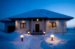House in winter. Lots of snow, evening mood stock image
