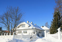 House in winter. House and garden covered with snow stock photo