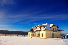 House in winter. A house in the winter with blue sky Royalty Free Stock Images