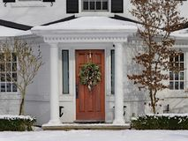 House in winter with Christmas wreath royalty free stock photos