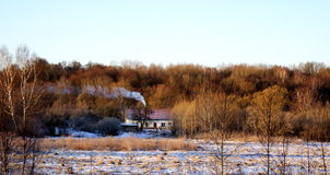 House in the winter forest Stock Image