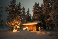 House in the winter forest. Cabin in Snow Covered Forest Royalty Free Stock Images