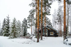 House in the winter forest. Cabin in Snow Covered Forest Royalty Free Stock Photos