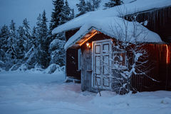 House in winter forest, North Finland Royalty Free Stock Image