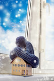 House in winter - heating system concept and cold snowy weather. With model of a house - insulation royalty free stock photos